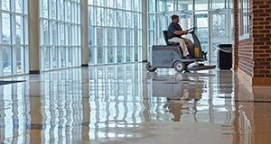 Cleaning a floor with an auto scrubber